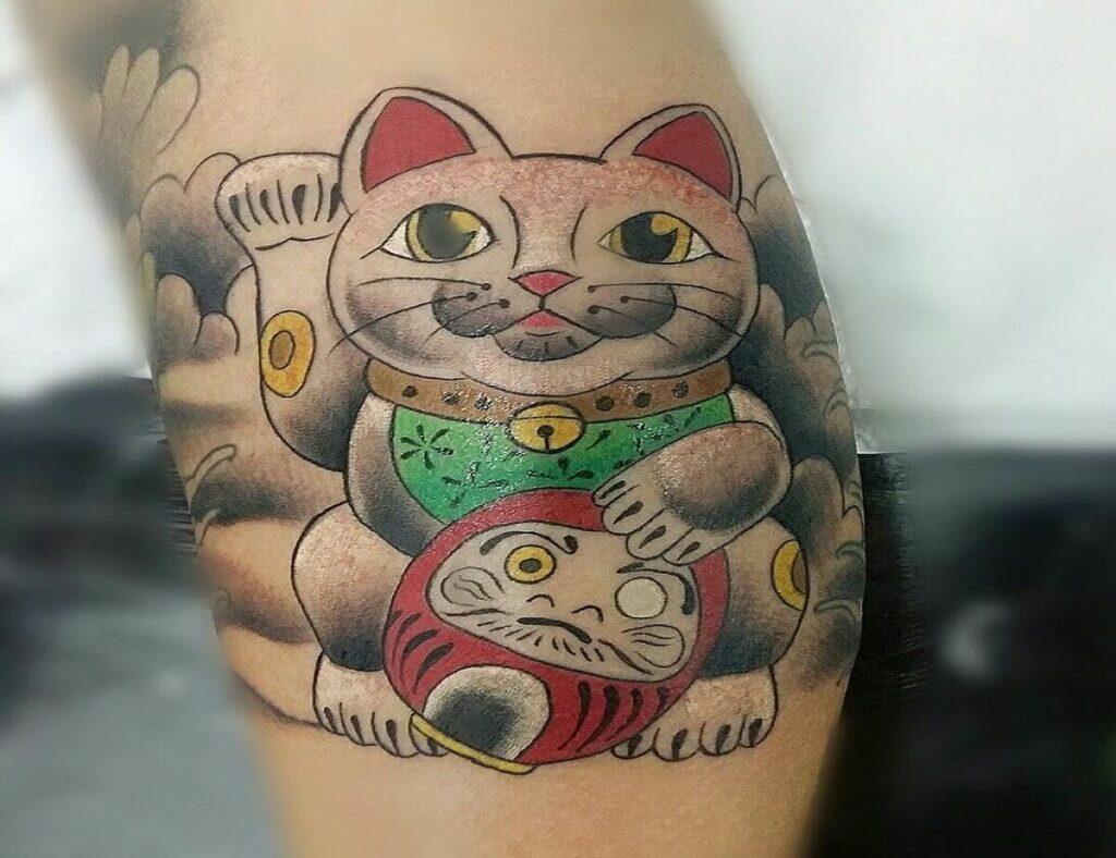 Ý nghĩa hình xăm mèo thần tài và vị trí xăm hình phù hợp nhất